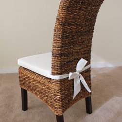 Banana Leaf Chair with Cushion - Made from all natural banana leaf, combining elegant textures with fitted lines. The perfect fit for nearly all stain colors and table styles.