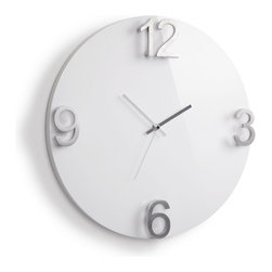 Finnley Wall Clock - Less is more when it comes to this minimalist wall clock. Sleek metal numbers stand out against the smooth wooden base board. Simple and to the point, this piece is sure to stand the test of time.