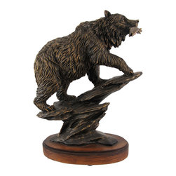 Bronzed Finish Bear Statue - A beautiful, bronzed bear statue is a wonderful gift for the wildlife enthusiast, or to compliment your own home decor! Made of cold cast resin, this statue measures 13 1/4 inches tall, 10 inches long, 5 inches deep and features a large bear with its fresh catch of the day in its mouth. The bronzed finish highlights the incredible detail of this piece, from the fish to the texture of the fur. It`s an eye-catching accent and looks great in offices or in the home on desks, bookshelves, and mantels.