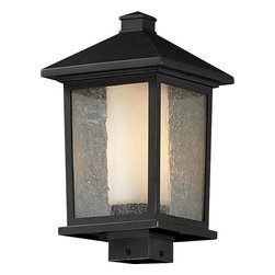 One Light Oil Rubbed Bronze Seedy + Matte Opal Glass Post Light - Unique double glass styling and rectangular detailing define the modern styling of this large outdoor post head. Seedy glass on the outside with matte opal inner glass creates an elegant glow, while the cast aluminum hardware finished in oil rubbed bronze can withstand nature's seasonal elements.