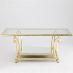 Desmond Coffee Table by Jan Showers - It's impossible to put this coffee table into a category. It is glamorous, it's regency, it's contemporary...the gold leaf makes a statement while the glass top keeps a room more open visually.