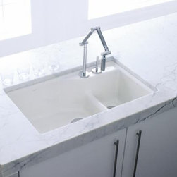 "Kohler - Kohler K-6411-2-0 White Indio Indio 33"" Double Basin Under-Mount - Product Features:Double basin sink with a 80/20 split provides increased versatility for any taskCovered under Kohler s limited lifetime warrantyThe large/medium basins allow you to keep clean and dirty dishes separate, while providing ample room for oversized pots and pansTwo bottom basin racks, a colander, and a walnut cutting board are included and custom-fit to work perfectly with the sinkConstructed of enameled cast-iron which combines strength, durability and insulation benefitsUnder-mount installation gives an integrated graceful look to the sinkOffset drain location increases workspace area in the sink as well as storage area underneathAll hardware needed for installation includedProduct Technologies / Benefits:Enameled Cast-Iron:  Kohler Enameled Cast-Iron combines the strength, durability, and insulation benefits of cast-iron with the scratch, chip, and burn resistance of a baked, powder coat finish and comes with an exceptional Lifetime Limited Warranty. When these materials are combined it gives the sink or tub the strength to last a lifetime of use. Kohler Enameled Cast-Iron is also available in a wide variety of specialty colors allowing you to truly customize your home.Smart Divide:  The basin divider is set to a lower height than perimeter of the sink; you gain the convenience of a single basin sink completely filled, without losing the functionality of a double basin sink. The lower divider also gives more room for working with larger pots and pans providing more access for filling and cleaning.Product Specifications:Height: 9-3/4"" (measured from the bottom of the sink to the top most point of the sink)Overall Width: 21-1/8"" (measured from the back outer rim to the front outer rim)Overall Length: 33"" (measured from the left out"