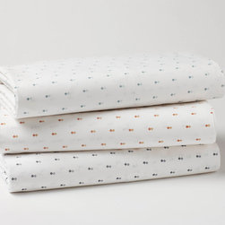 """Double Diamond Sheet Set - On smooth white organic 220 percale cotton, the tiny tonal diamond pattern offers a fresh and timeless look. The print is made from GOTS-certified dyes. Flat sheet has a self-hem. Fitted sheet has a deep 15"""" pocket and full elastic to accommodate a range of mattresses. Cases have envelope construction to neatly hide the pillow. Sourced and woven in India."""