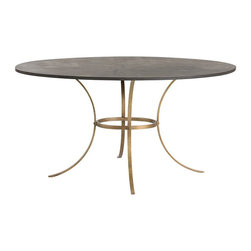 Arteriors - Harlow Table - The Harlow Table features gently curved flat iron legs finished in antique brass that support the blackened distressed iron oval top. A dining table that is both elegant and industrial.