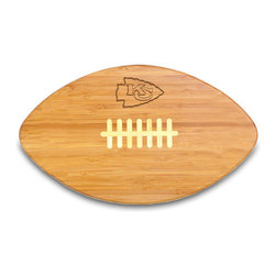 "Picnic Time - Kansas City Chiefs Touchdown Pro Cutting Board in Natural Wood - The Touchdown! cutting board is a 15"" x 8.75"" x 0.75"" board made of eco-friendly bamboo with a standard football design, with 123 square inches of cutting surface. It can be used as a cutting board or serving tray, or use both sides of the board, one for cutting and the other for serving. The backside of the board is solid dark bamboo. Go long...for the Touchdown! Decoration: Engraved"
