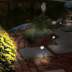 Frontgate - Solar Garden Spotlight - One-watt LED warm white spotlight. Remote solar panel with rechargeable batteries. Illuminates distances up to 25'; 25 degree beam range. Cord measures 6' from solar panel to light. Provide light where it's most needed with our Solar Garden Spotlight. This easy fix lighting solution is ideal for adding accent illumination to steps, shrubs, flags, address markers, fountains, statuary and other landscape elements outside of your home.  .  .  .  .