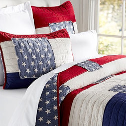 Stars and Stripes Quilt - This Americana bedding set, while not necessarily intended for a kid's room, could grow with a little boy. I love the appliquéd stars and how the blue almost looks like denim.