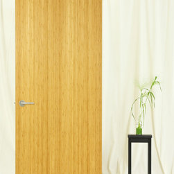 Low cost interior door option for loft make-overs - A flush door with an uncluttered appearance and a rich, natural wood veneer is the perfect offset to painted jamb/case/base/cove. Here: Reconstituted teak veneer made with a clever dye-and-stack process utilizing species that grow in abundance and at a lower monetary and environmental cost than real teakwood. Real wood, a no VOC finish and complementary for newly renovated decor with either painted or stained wood trim.