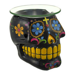 Zeckos - Black Day of the Dead DOD Scented Oil Warmer - This awesome oil warmer is a wonderful addition to any skull collection It features an elaborate, colorful Mexican Day of the Dead design, and is sure to be admired. Made of cold cast resin, it measures 3 1/2 inches tall, 4 inches wide, 4 1/2 inches long, and has a 4 inch diameter glass dish. The artfully placed decals are coated with polyurethane to keep them bright for years. A tea light candle (not included) is all you need to warm the scented oil of your choice. This piece makes a great gift for a friend.