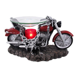 `Born to be Wild` Red Motorcycle Electric Oil Warmer - This electric oil warmer is a lovely addition to your home decor! Not only is it visually appealing, it is a safe alternative to traditional oil warmers that use candles to heat the oil or wax cubes. This cold cast resin piece measures 5 3/4 inches tall, 10 inches long, 4 1/2 inches deep, with the glass dish measuring 4 1/2 inches in diameter. The glass light bulb cover is 2 1/2 inches tall, 1 1/2 inches in diameter and casts a fiery red hot glow. The 5 1/2 foot long white power cord has an on/off dial that allows you to adjust the intensity of the light and fragrance to your liking. This piece is wonderfully detailed, from the color and texture to the hand painted accents, and is part of a limited edition of 5000 pieces.