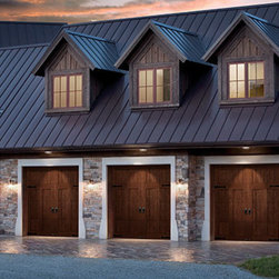 Clopay Canyon Ridge Collection - Regardless of the exterior style of your home, wooden garage doors can be the perfect finishing touch to enhance your home's curb appeal.