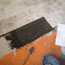 Bathtub installation -- order of installation (end pony wall, tub, heated floor)