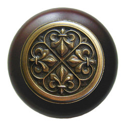 "Inviting Home - Fleur-de-Lis Walnut Wood Knob (antique brass) - Fleur-de-Lis Walnut Wood Knob with hand-cast antique brass insert; 1-1/2"" diameter Product Specification: Made in the USA. Fine-art foundry hand-pours and hand finished hardware knobs and pulls using Old World methods. Lifetime guaranteed against flaws in craftsmanship. Exceptional clarity of details and depth of relief. All knobs and pulls are hand cast from solid fine pewter or solid bronze. The term antique refers to special methods of treating metal so there is contrast between relief and recessed areas. Knobs and Pulls are lacquered to protect the finish. Alternate finishes are available. Detailed Description: The Fleur-de-lis means ""flower of the lily"" It was used to represent French royalty. It was said that the king of France Clovis who started using the symbol of the Fleur-de-lis because the water lilies helped guide him to safety and aided him in winning a battle. The design in the Fleur-de-Lis pulls is arranged in alternating positions of the Fleur-de-lis. These pulls are a great match for the Fleur-de-lis knobs which have the Fleur-de-lis pattern arranged in a circle. The different shapes of decorative hardware make the cabinet doors and drawers interesting to look at."