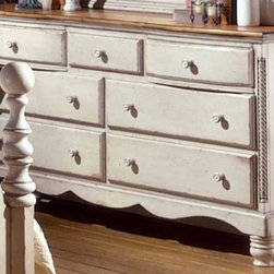 Hillsdale - Seven-Drawer Dresser With English Dovetail Jo - Heirloom quality with top-notch construction, this seven-drawer dresser displays an antique white finish with sculpted circular feet. Scalloped kick plate and carved drawer pulls. English dovetail joints plus an antique pine finish on the large top. Carved rope design on either side. * For residential use. Antique White finish with Antique New Zealand Pine top. English dovetail joints. Seven drawers. Large top. Minor assembly may be required . 68.75 in. W x 19.625 in. D x 38.24 in. H