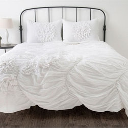 Rizzy Home - Rizzy Home Hush Comforter Bed Set Multicolor - BT1058KING - Shop for Bedding Sets from Hayneedle.com! As soft as a whisper the Rizzy Home Hush Comforter Bed Set adds a dramatic beauty to your bedroom. The gauzy look of the voile cotton fabric features ruching for a chic look. Details like floral applique and embroidery add the of touches that make this a truly gorgeous set. Dry clean only available in your choice of size.Comforter Dimensions:Twin: 68L x 92W in.Full/Queen: 92L x 96W in.King: 96L x 108W in.About Rizzy HomeRizwan Ansari and his brother Shamsu come from a family of rug artisans in India. Their design color and production skills have been passed from generation to generation. Known for meticulously crafted handmade wool rugs and quality textiles the Ansari family has built a flourishing home-fashion business from state-of-the-art facilities in India. In 2007 they established a rug-and-textiles distribution center in Calhoun Georgia. With more than 100 000 square feet of warehouse space the U.S. facility allows the company to further build on its reputation for excellence artistry and innovation. Their products include a wide selection of handmade and machine-made rugs as well as designer bed linens duvet sets quilts decorative pillows table linens and more. The family business prides itself on outstanding customer service a variety of price points and an array of designs and weaving techniques.