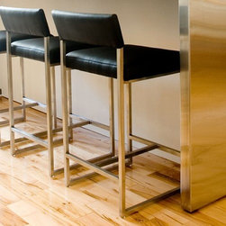 Gus Modern - Graph Stool - Quick Ship   Gus Modern - Architecturally-inspired, the Graph Stool is built to last with a stainless steel frame and upholstered seat/back. A padded seat and back make the Graph Stool a comfortable choice to pull up to the counter or high dining table while the simple cube design pairs with both traditional and modern interiors. Plastic bumpers on all four corners prevent floor damage from occurring and make the Graph Stool a practical choice. The Graph Stool is available with a vinyl seat and backrest with your choice of color. All fabric is CA 117 certified and double rub tested.Available in other non-Quick Ship options, see Graph Stool.