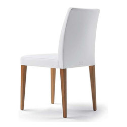 Poltrona Frau - Poltrona Frau Liz Dining Chair - The Liz Dining Chair is available with or without arms. The frame is built in seasoned beech wood. Firm seat suspension is provided by elastic bands. Polyurethane foam is used for the padding. Linearity seems to be the key word of this model. A style that recalls the formal language of the Fifties. Price includes delivery to the USA. Manufactured by Poltrona Frau.Designed in 2000.