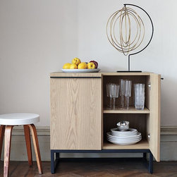 Metal-Leg Dining Console - An ideal small-space storage solution. Light on its feet and cool in color, with graphite-colored metal accents, this petite console conceals more than it reveals. Its two doors swing open to reveal adjustable, interior shelves and a removable wine rack that can hold up to 12 bottles.