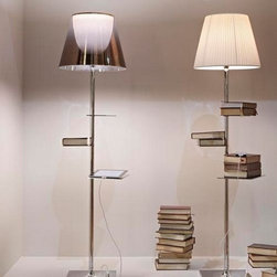 Bibliotheque Nationale Floor Lamp by Flos - Bibliotheque Nationale Floor Lamp by Flos. Floor lamp with diffuse light. Base, rod stand and diffuser stand in chrome-plated die-cast zinc. Base cover in zinc-plated P04 steel sheet. Internal diffuser and lamp-holder stand in opal coloured injection die-stamped PC. The external diffusers are available in matching PVC fabric, injection die-stamped methacrylate with clear or smoke-grey finish, or in silver or bronze on the inner surface, by vacuum aluminum coating. Upper ring in clear injection die-stamped PC. Brackets in polished stainless steel. A USB outlet placed on the base enables the most common smartphones and tablets to be recharged (max 2A). Bibliotheque Nationale Floor Lamp by Flos are designed by Philippe Starck.
