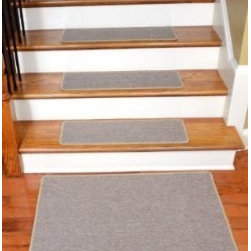 "Dean Flooring Company - Dean Serged DIY Carpet Stair Treads 27"" x 9"" - Beige Suede - Set of 13 Plus Mat - Dean Serged DIY Carpet Stair Treads 27"" x 9"" - Beige Suede - Set of 13 Plus a Matching 2' x 3' Landing Mat : Quality, Stylish Carpet Stair Treads by Dean Flooring Company Extend the life of your high traffic hardwood stairs. Reduce slips/increase traction (your treads must be attached securely to your stairs). Cut down on track-in dirt. Great for pets and pet owners. Helps your dog easily navigate your slippery staircase. 100% Polypropylene. Set includes 13 carpet stair treads plus a matching 2' x 3' landing mat and one roll of double-sided carpet tape for easy, do-it-yourself installation. Each tread is serged around the edges with beautiful color matching yarn. Rounded corners. No bulky fastening strips. You may remove your treads for cleaning and re-attach them when you are done. Add a touch of warmth and style and a fresh new look to your stairs today with new carpet stair treads from Dean Flooring Company! This product is designed, manufactured, and sold exclusively by Dean Flooring Company."