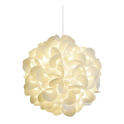 Akari Lanterns - Round Hanging Pendant Lamp - Capture the feeling of a paper lantern rising against the night sky in your home with this round-cut, snow white version. A magical light envelopes you and bathes the room in a creamy glow. Inside that warm radiance, nights are sweet, thoughts are calm and dreams are possible. Available in three sizes.