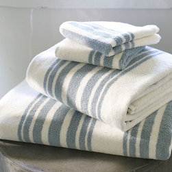 Riviera Stripe Organic Bath Towels - These organic striped bath towels look both modern and deliciously soft (and environmentally friendly). Towels are a great way to add a subtle pattern to an ordinary bathroom.Dimensions vary. Price ranges by size from $9 to $29.