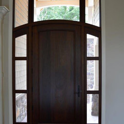 Custom entry door - Interior view of solid panel arch top mahogany front door with matching transom and sidelites.  Very contemporary style looks great with a varied range of new home styles.