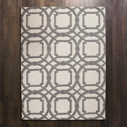 Global Views Grey Ivory Arabesque Rug - I love this new gray and ivory rug from Global Views.  It's so chic and sophisticated. Just add a pop of orange or coral for a hip, modern look.