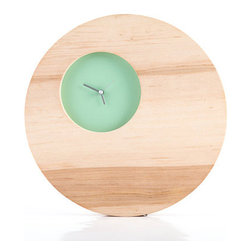 Double Circle Wall Clock in Mint - Mid-century modern inspired, these clocks are created from solid pieces of wood and feature a small colorful opening to show the time.   Made of natural alder wood, different patterns in the wood grain make each clock unique.  The pattern of the wood will differ slightly from the images here.