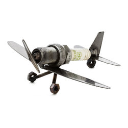 Craftsman Reclaimed Metal Handmade Plane Paperweight - Whether it lands in the hands of the person manning the cockpit of your company or the handyman or woman who always knows how to keep your household running, Brian Mock's industrial paperweight provides a clever way to show how much you appreciate everything they do. Recycled spark plugs, butter knives, nut and bolts are welded together into the iconic shape of an airplane, giving this delightful mini-sculpture the power to take off with the conversation as it taxis around your desk, workshop or tool shed