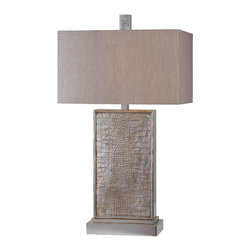 Ren-Wil - Kovarro 29-Inch Table Lamp - The Kovarro lamp features a beautiful silver leaf finish with a subtle wash to enhance the trendy snake skin patterned base. This lamp is finished with a crisp linen shade and matching finial.