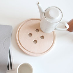Snug.Buttonboard by Snug.Studio - If a bar tray is not really your style, try a tea tray instead! I love this fun wooden button board from Snug.Studio. Use it as a trivet for your hot teapot and favorite cups.