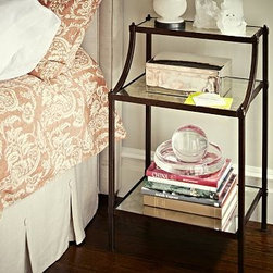"Etagere Antique Mirror Bedside Table, Aged Iron finish - Like a gardener's potting table, our table offers ample storage on three tiers. The shelves' antiqued mirror tops create a stylish contrast to the distressed frame. 21"" wide x 16'' deep x 35.5'' high Crafted of iron and finished in Aged Bronze. Features three antiqued mirror shelves with MDF backing."