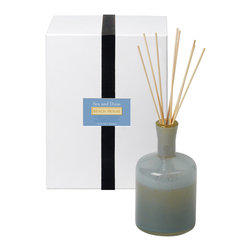 Sea and Dune / Beach House Diffuser - 15 oz. - The Sea and Dune Beach House Diffuser carries you on a breeze from a coastal hideaway each time you inhale its complex, refreshing aroma: bundles of fresh sea grass,�the salty coolness of the ocean, the wind carrying you a hint of warm sand lying under the summer sky.� A dark seaglass-colored bottle holds the aromatic oil and the cluster of wooden reeds that carry it into your air.