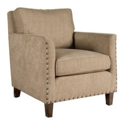 Uttermost Keturah Armchair - Experience plush comfort at home with the Uttermost Keturah Armchair. Designed to be stylish and sturdy this armchair has a hardwood frame that supports neutral driftwood-toned cushions and arms. It has loose box cushions draped in supple dobby chenille fabric for optimal seating comfort. Traditional in style this armchair features squared-off lines which are offset by arms that are curved on the inside. Brass nail-head trim and sun-washed pecan block feet enhance its visual appeal.