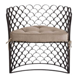 Vero Iron/Linen Chair - Light filters exquisitely through the fine, scalloped natural iron screen which forms the basic structure of the Vero Chair. With its scale-patterned openwork back bent into a demilune shape, this chair captures the casual depth of a box-armed seating option but maintains a light Mediterranean elegance through its construction. A removable, semi-circular natural linen cushion comfortably pads the seat of this chair for patio dining or transitional living rooms.