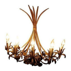Pre-owned Vintage 5-Arm Italian Wheat Tole Sconce - Italian gilt metal five-arm sconce in graceful wheat motifs. This chandelier is wired and in working condition with an outlet plug that has been spliced and repaired, and uses 5 40W candelabra bulbs. The sconce could also be hardwired if desired.  There is a wall mount near the top of the fixture with a nail hole to securely affix it to your wall. A stunning gilt addition to your dining room, entryway or bedroom.