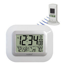 La Crosse Technology - Atomic Digital Clock with Wireless Solar-Powered Outdoor Temp - Wall clock or Table Clock capability. Has two legs which pull out to sit on a surface. Solar-powered wireless outdoor temperature sensor. Wireless outdoor temperature (°F). Monitors indoor temperature (°F). Atomic time and date. Battery opertated. 12/24-Hour time display. Time alarm with snooze. Wall-hanging or free-standing. Time Digits: 1.8 in. Tall. Non-Time Digits: 0.75 in. Tall. 9 in. W x 0.75 in. D x 7.1 in. H