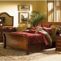 Aspen Home - Classico Sleigh Storage Bed Multicolor - ASPN274 - Shop for Beds from Hayneedle.com! Exotic elegance combines with function in the Classico Sleigh Storage Bed. This beautifully crafted bed features a traditional design embellished with gorgeous grape vine moldings on the headboard and nailhead trim around the edges. For those in need of storage spacious drawers are available offering an abundance of room for blankets linens and other bedroom items. Constructed of poplar solids with ash and cherry veneers then completed with a warm cherry finish.About aspenhomeOver the past 30+ years aspenhome has transformed from a small family owned entertainment business in Phoenix to a full-line furniture company specializing in thoughtful innovative products designed for the way people work play and relax at home. Aspenhome has received a number of recognitions including: 6 Pinnacle Design awards Consumer's Digest Best Buy for home entertainment Home Furnishing's News Award of Excellence for entertainment and Furniture Today's 2008 Supplier of the Year. Aspenhome is a proud sponsor of City of Hope dedicated to the research treatment education prevention and cure of cancer and other life-threatening diseases.