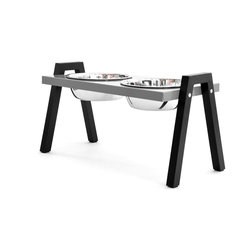 Doca Pet - Stray Dog Diner - Made in Chicago, this contemporary dog diner elevates your dog's dishes for his dining comfort. The sturdy sawhorse design keeps even the most enthusiastic eaters from knocking it over. Two dog dishes are included.