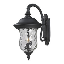 "Z-Lite - Armstrong Outdoor Wall Light in Black - Traditional charm emanates from this large outdoor wall mount fixture, which pairs clear water glass with black hardware for a timeless look.; Collection: Armstrong; Frame: Black, Aluminum; Shade: Clear Waterglass, Glass; Bulb: 60 watts, Candelabra base; No. of bulbs: 3; Bulb not included.; UL Application: Wet; Dimensions: 16""L x 12.32""W x 24.29""H; Weight: 6.94 lbs."