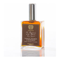 Vanilla, Burbon & Mandarin Room Spray 100 ml. - An unusual, sensual, and poetically unisex blend with a nostalgic feel, Vanilla, Bourbon, and Mandarin Room Spray is an excellent companion to lazy late mornings in bed, to pre-date baths, and to long drinks in a chic, eclectic sunroom.  One touch to the glass spray bottle with its transitionally-styled dark label releases crisp citrus, lingering spicy bourbon, and relaxing vanilla into the air.