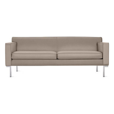 Theatre Sofa - Leather - Design Within Reach - Modern sofas often claim minimalist appeal, but few can also tout the comfort of the Theatre Collection (2001).  Designed to accommodate the human body with studied proportions and simple geometry, Theatre's comfort stems from its form rather than excessive layers of stuffing. With a gently angled backrest, full seat depth and elevated armrests, Boerner's signature artisan details are evident throughout. A gleaming chromed steel base runs the entire depth of the design, and welted seams lend strength and definition to the upholstery.