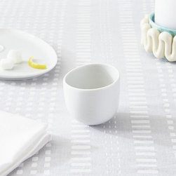 Como White Espresso Cup - Organic shapes in white porcelain dinnerware play neutral companions to the brilliant colors and expressive motifs of the Paola Navone tableware collection.