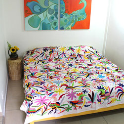 King-Size Birds Multicolored Otomi Piece by Casa Otomi - This Otomi bedspread via Casa Otomi on Etsy is conveniently sized for a king bed. It's such a colorful and creative idea for a guest room.