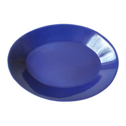 Oval Serving Dish, Midnight Blue - Midnight blue on the inside, chalk white on the outside. Serving food from this hand-crafted dish makes any meal look and taste better. Mix and match with other colored tableware.