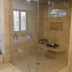 Frameless steam Shower Enclosure - Fully frameless steam shower enclosures.  Curbless design.  This glass enclosure features an operating transom in the fixed panel.