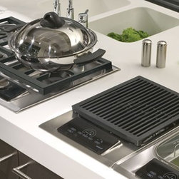 Wolf 15-Inch Integrated Cooktops - Having a separate independent steamer, grill or induction cooktop in addition to a traditional gas range is a home cook's ultimate dream set up.