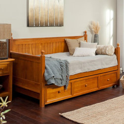 Leggett & Platt - Casey Daybed-Honey Maple Multicolor - RN643 - Shop for Daybeds from Hayneedle.com! Perfect for a guest room kids room or office space the Casey Daybed-Honey Maple is an attractive traditional daybed in a versatile honey maple finish. The sides and back are solid slats of wood carved in a cottage-style beadboard design. Rounded wood finials finish off each square post. As practical as it is beautiful this daybed comes with an optional roll-out trundle drawer that can be used for extra storage or for sleeping space when you put up to an 8-inch-thick mattress inside. This daybed uses a standard twin-size mattress. The included wooden slat support system is 15 inches from the floor. Assembly required. Ships via common carrier. Dimensions: Daybed: 81.5L x 41.6W x 45.5H inches Trundle: 76L x 40W x 13H inches Side panel: 33H inches Finial ball: 3H inches About Fashion Bed GroupFashion Bed Group is a Leggett and Platt Company known for its innovative fashion beds daybeds futons bunk beds bed frames and bedding support. Created in 1991 Fashion Bed Group is a large consolidation of three leading bed manufacturers. Its beds are manufactured of genuine brass plated brass cast zinc cast aluminum steel iron wood wicker and rattan. Fashion Bed Group's products are distributed throughout North America from warehouses located in Chicago Los Angeles Houston Toronto and Ennis Texas.