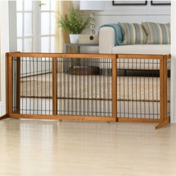 Freestanding Wood Gate Extra Wide - 20 in. - The Freestanding Wood Gate Extra Wide - 20 in. is a striking example of how a pet gate can be pet great. First of all, it's beautiful. Crafted of finely finished wood with metal bars, this gate doesn't intrude on any room's style. The side panels and wide base give the gate great stability. Rubber feet keep your floor safe from scratches, and the gate folds easily for storage.